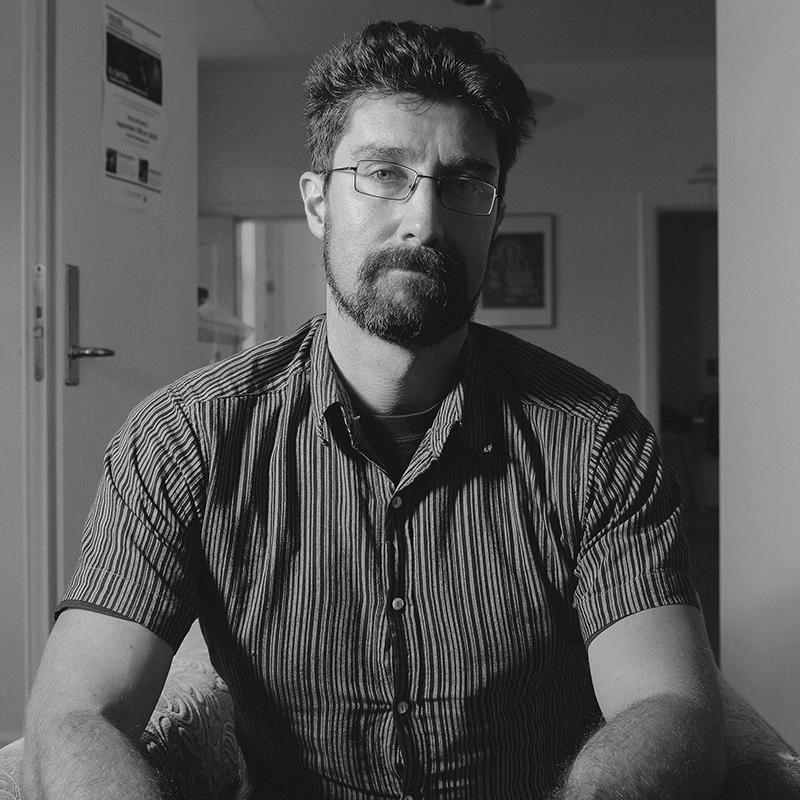 Black and white image of Ryan Holmberg